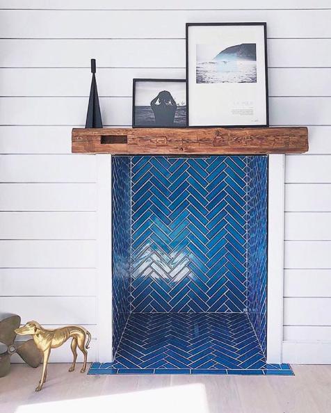 Blue herringbone tile fireplace