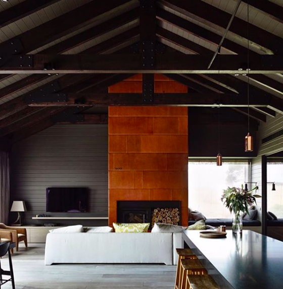 Rusted metal cladding around cool fireplaces