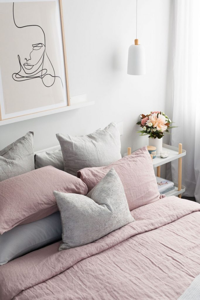Dusty rose bedding and grey cushions