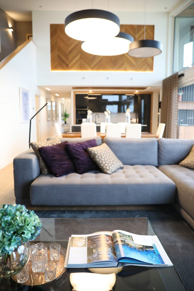 Cushions on sofa to add cosiness to open plan homes