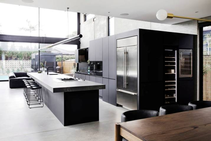 Black kitchen with full sized wine fridge Guy Sebastian kitchen