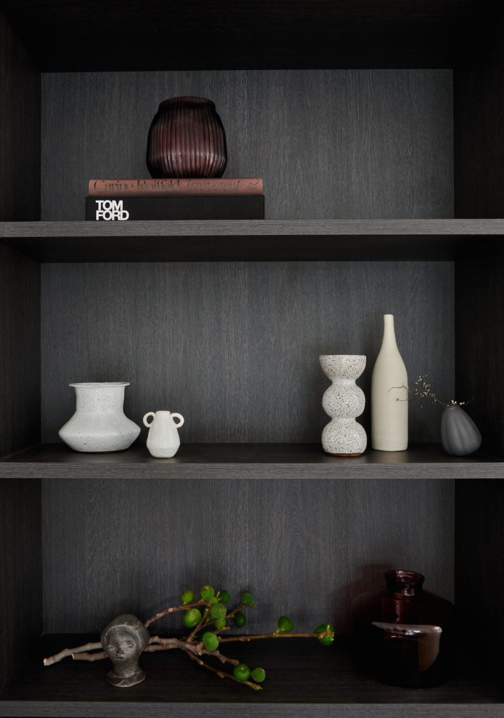 Dark veneer bookcase with ceramic styling