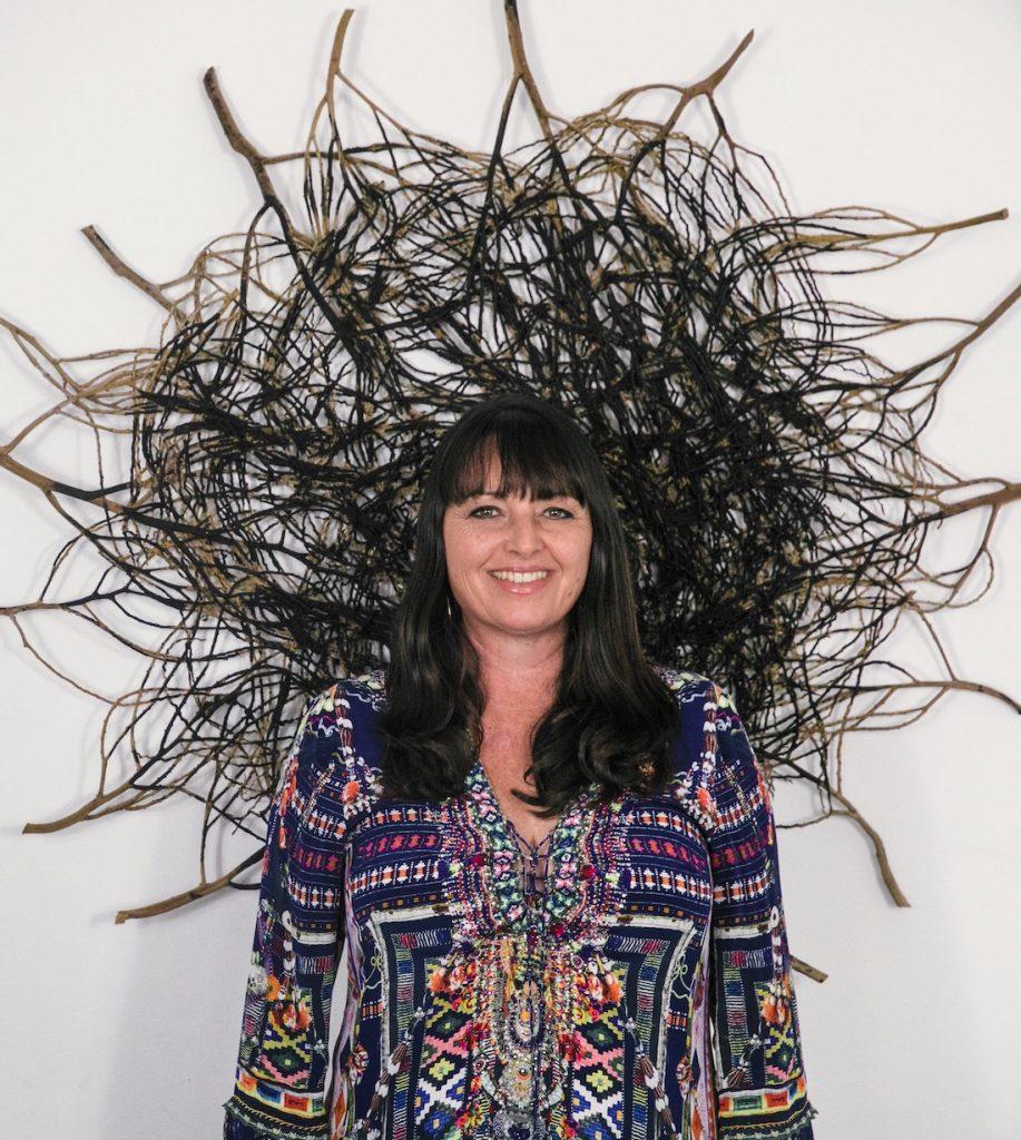 Catriona Pollard_artist profile with woven art piece
