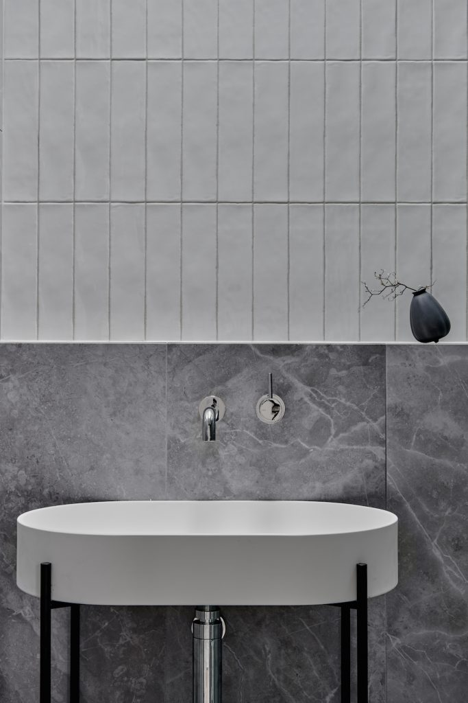 Close up of sink and half height wall tiles