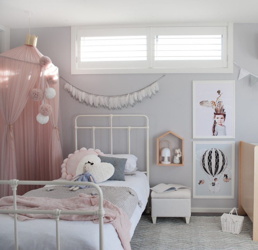 Girls bedroom with pink canopy