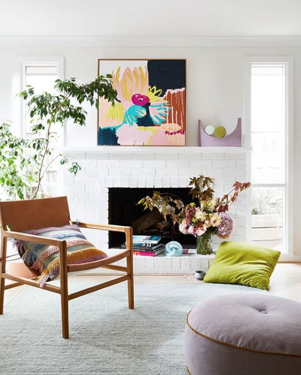Bright and colourful living room styling on a fireplace mantel