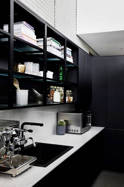Black cabinetry inside butlers pantry
