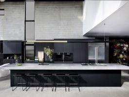 Black and grey kitchen with extra long bench