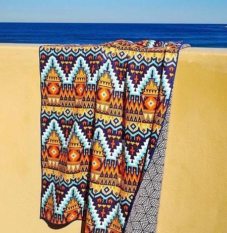 Tesalate towel hanging over wall