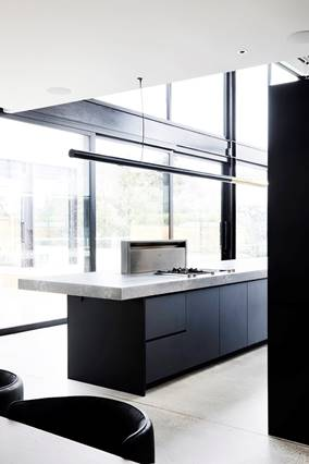 Floor to ceiling windows in black kitchen