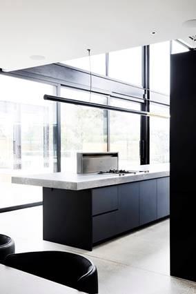 Floor to ceiling windows in black kitchen