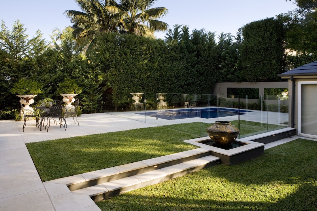Outdoor garden pool area with grass and paving
