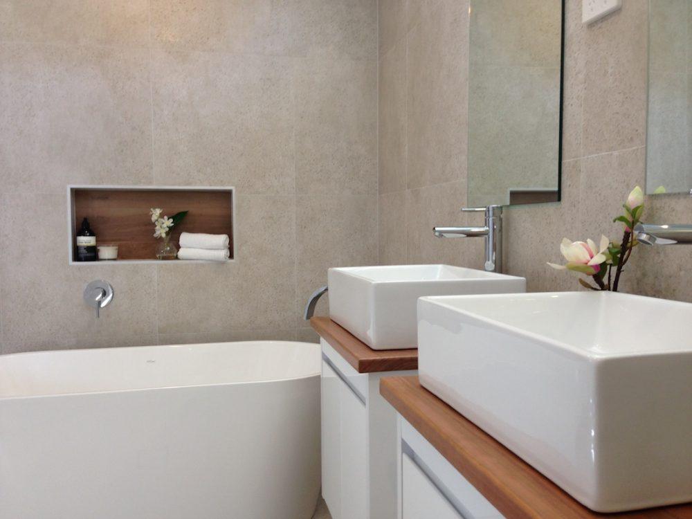 Double vanity bathroom with freestanding bath