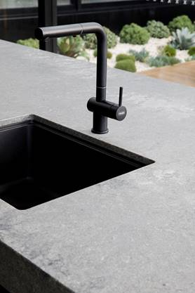 Black sink and tap in stone bench Guy Sebastian kitchen