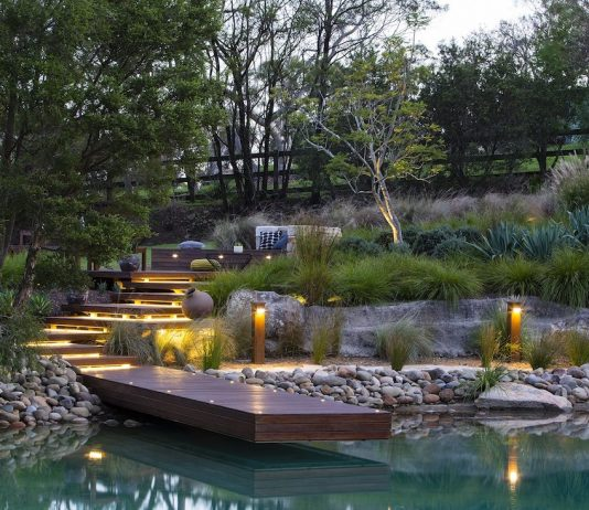 Tiered garden with wooden pontoon and lighting