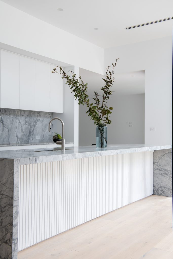 White and stone kitchen in this modern home