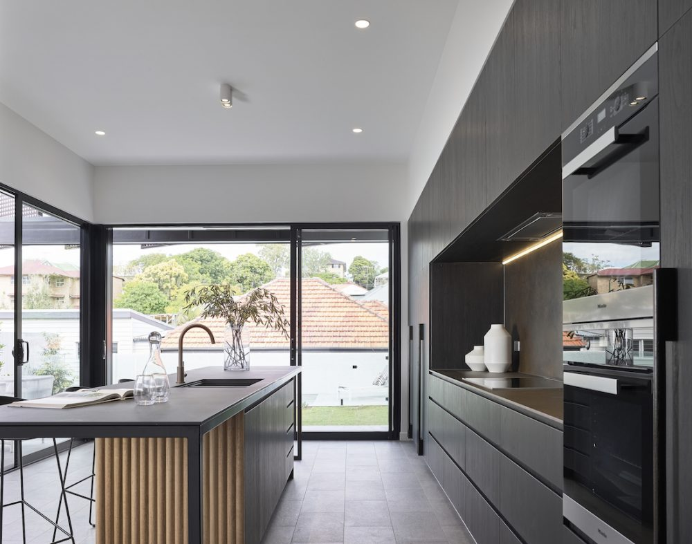 Black and wood feature kitchen modern construction