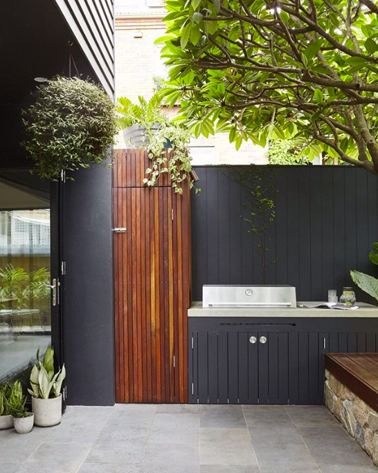 Black and timber outdoor kitchen