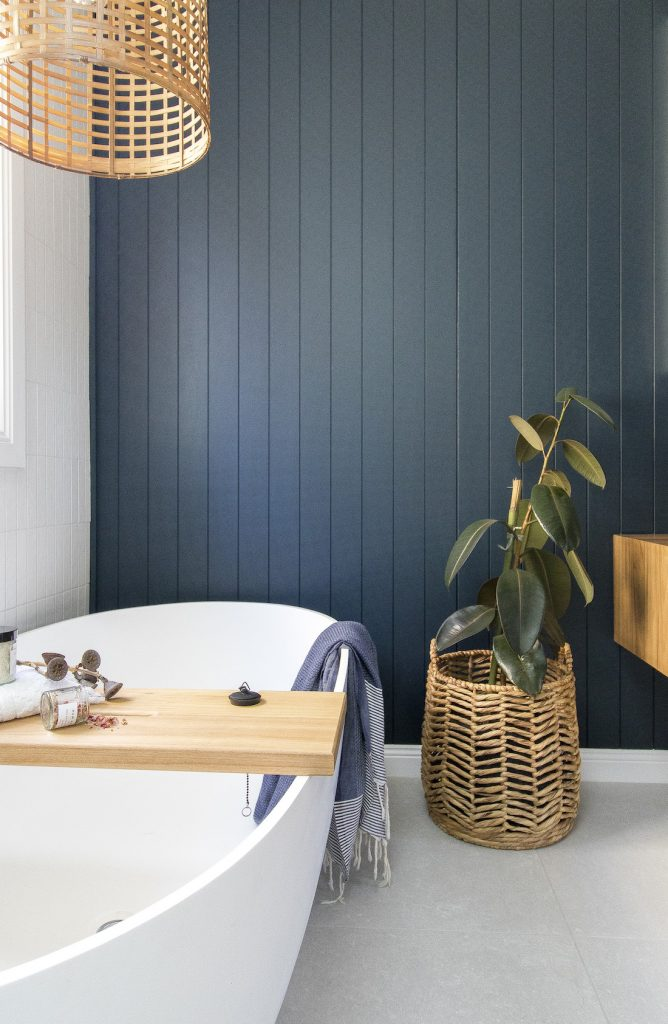 Blue panelling bathroom wall with freestanding bath