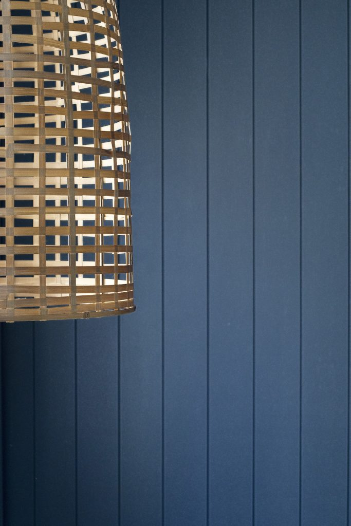 Blue panelling wall with basket light