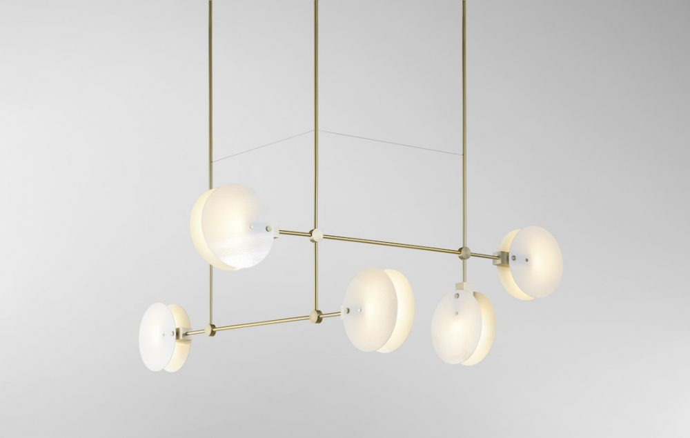 Brass and white chandelier lighting by Ross Gardam