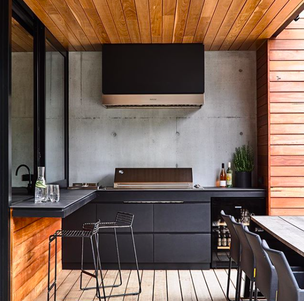 Concrete and black outdoor kitchen