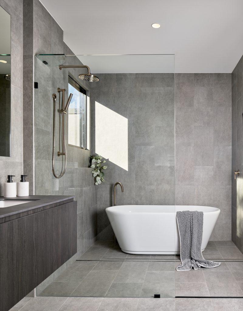 Main bathroom grey tiles floor to ceiling modern construction