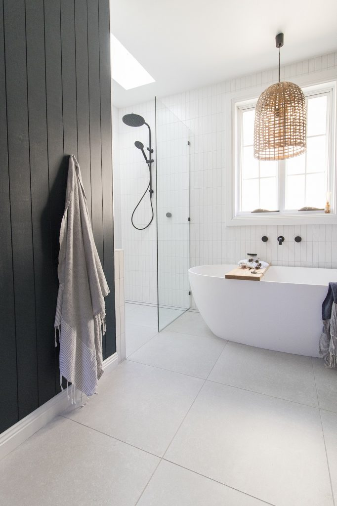 White bathroom with dark wall panelling in coastal luxe bathroom