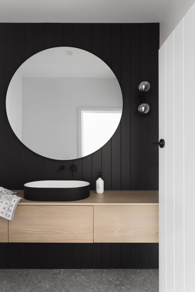 Beaumaris black joinery powder room by  GIA Bathrooms & Kitchens