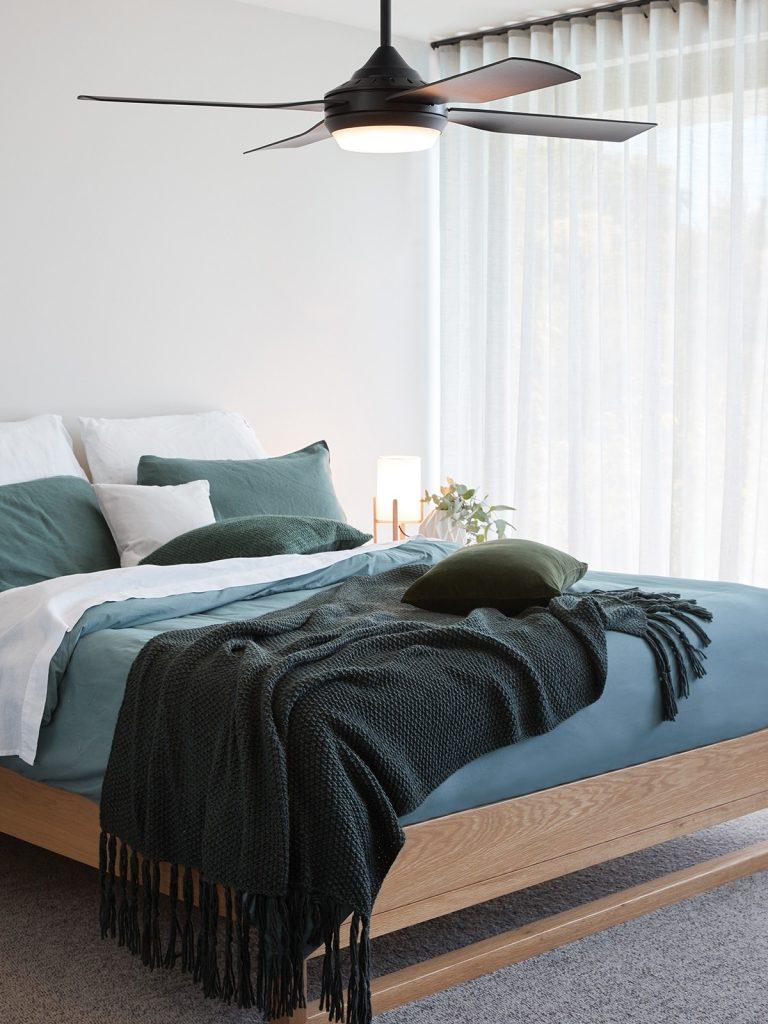 Black fan in bedroom