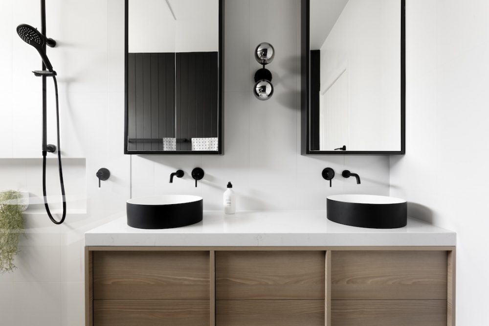 Black feature bathroom with double vanity by GIA Bathrooms & Kitchens