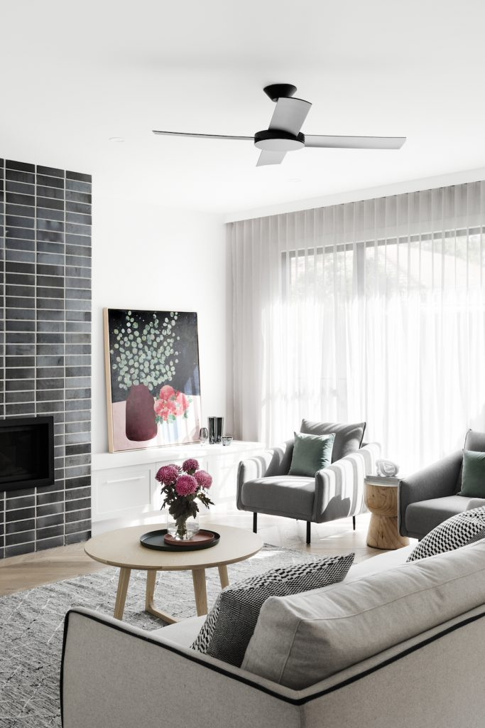 Neutral living area with tiled fireplace