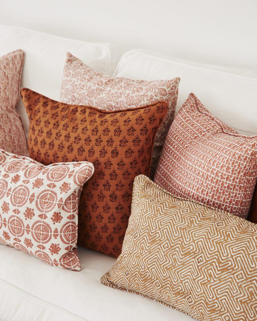 Terracotta tone hand printed cushions Walter G