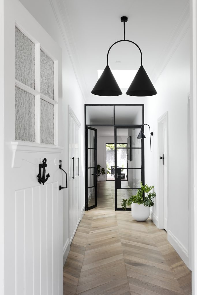 White and black interior with chevron floor