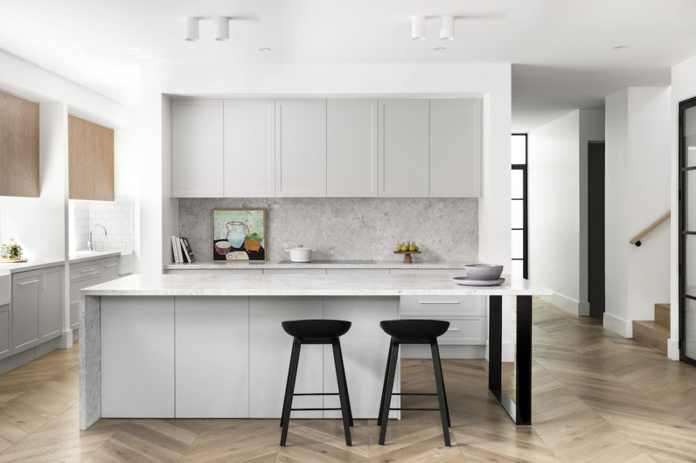 White and black kitchen with stone island