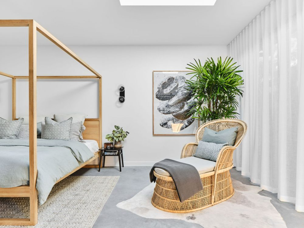 Cane lounge in neutral bedroom
