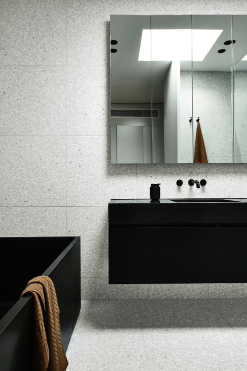 Grey and black bathroom with sharp edge bath