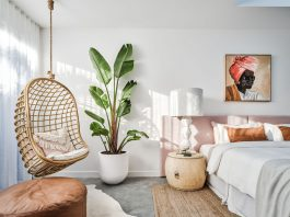 Hanging swing chair in pink neutral bedroom
