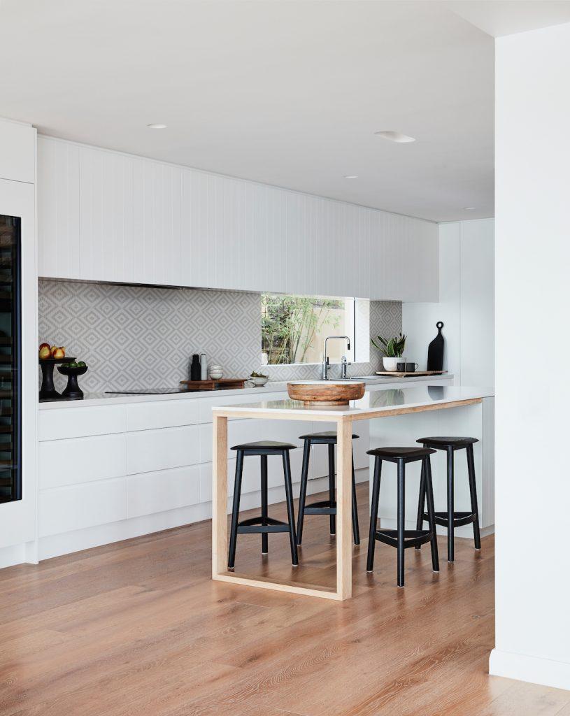 Island bench in white kitchen styled by Oliver Myles