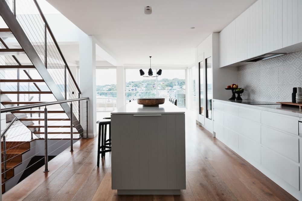 Kitchen with a view and open staircase by Oliver Myles