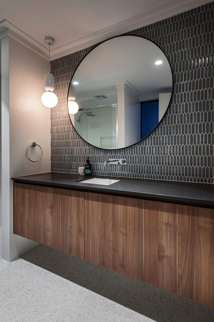 Bathroom with round mirror and statement tile_Coolbinia