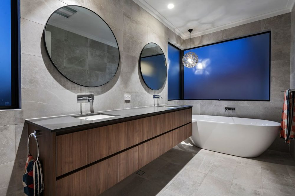 Bathroom with statement tub and round mirrors