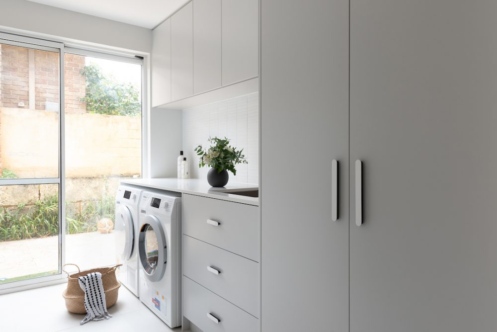 Functional family laundry transformation by Jane Ledger