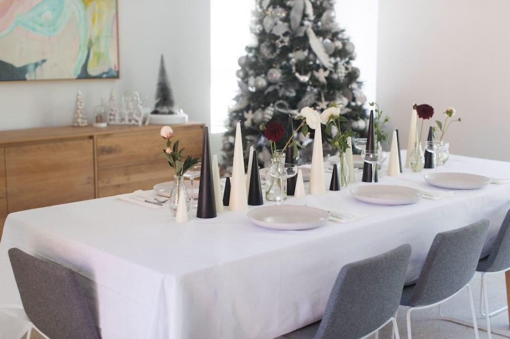 Black and white candle and floral table setting