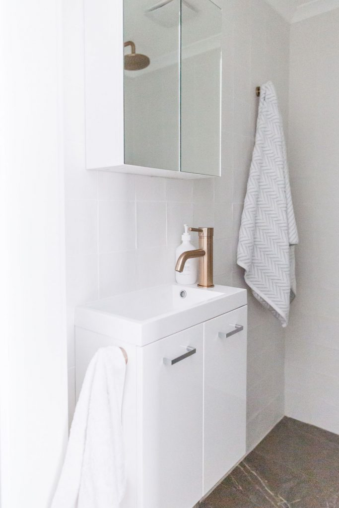 Mirrored cabinet in smallest bathroom