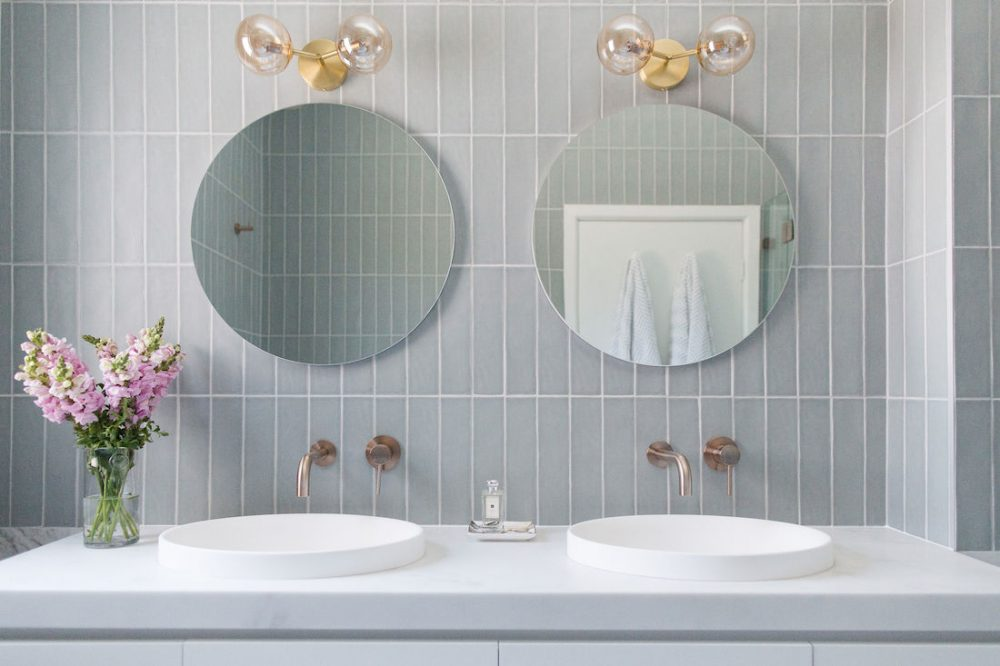 Erskineville main bathroom_round mirrors, sinks, bold lighting