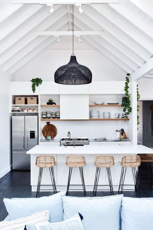 Coastal kitchen with boho chic open style shelves