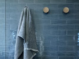Dark blue subway tile bathroom