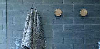Dark blue subway tile bathroom