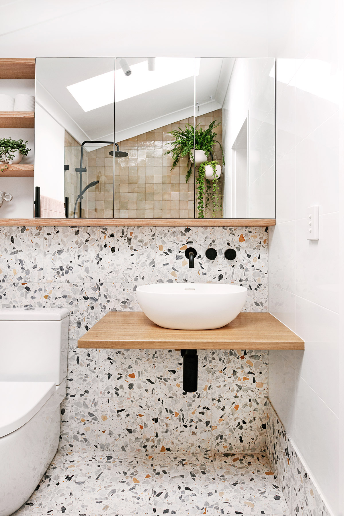 Terrazzo bathrooms that don't use white tiles